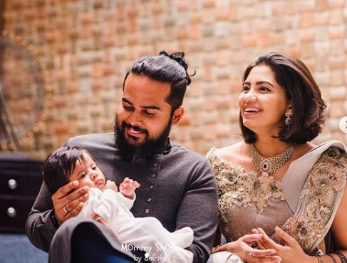 Disha Madan with her husband and child